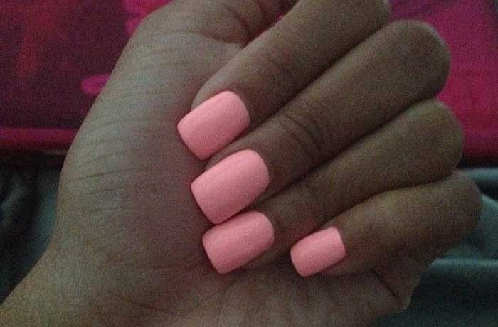 Coral Nail Polish On Golden Dark Skin